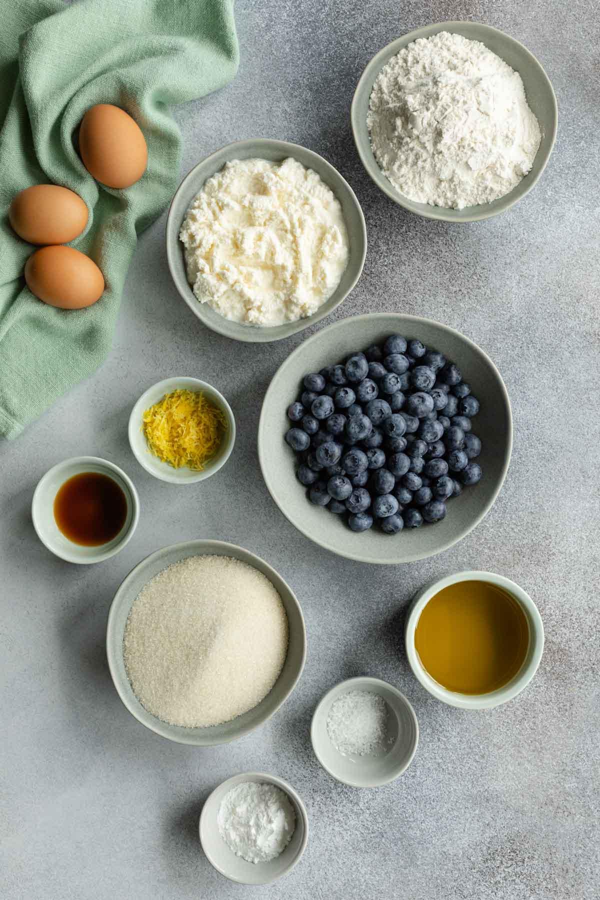 Ingredients to make blueberry cake arranged individually.