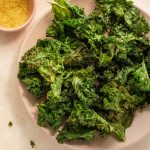 Air Fryer Kale Chips arranged on a pink plate.
