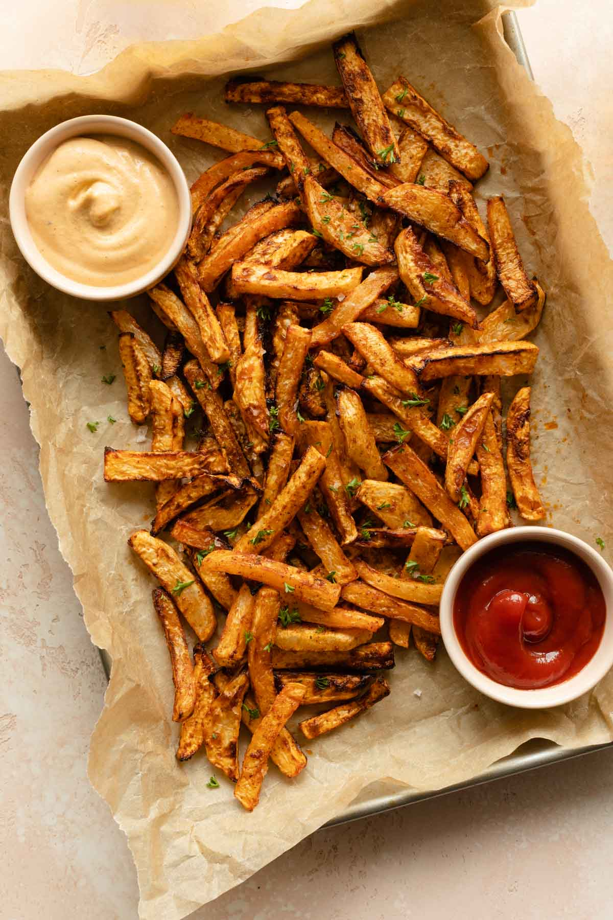Turnip fries served on a tray with some dips.