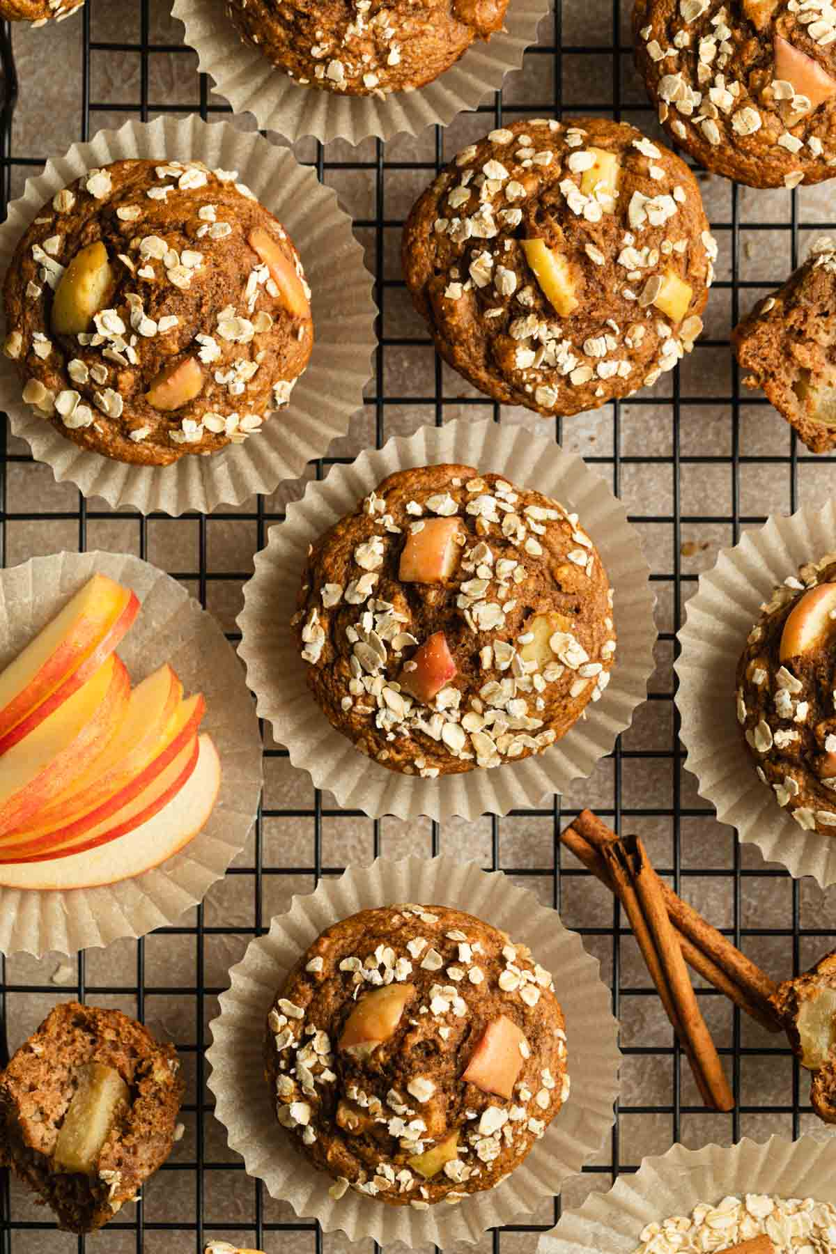 Apple muffins on a wire rack.