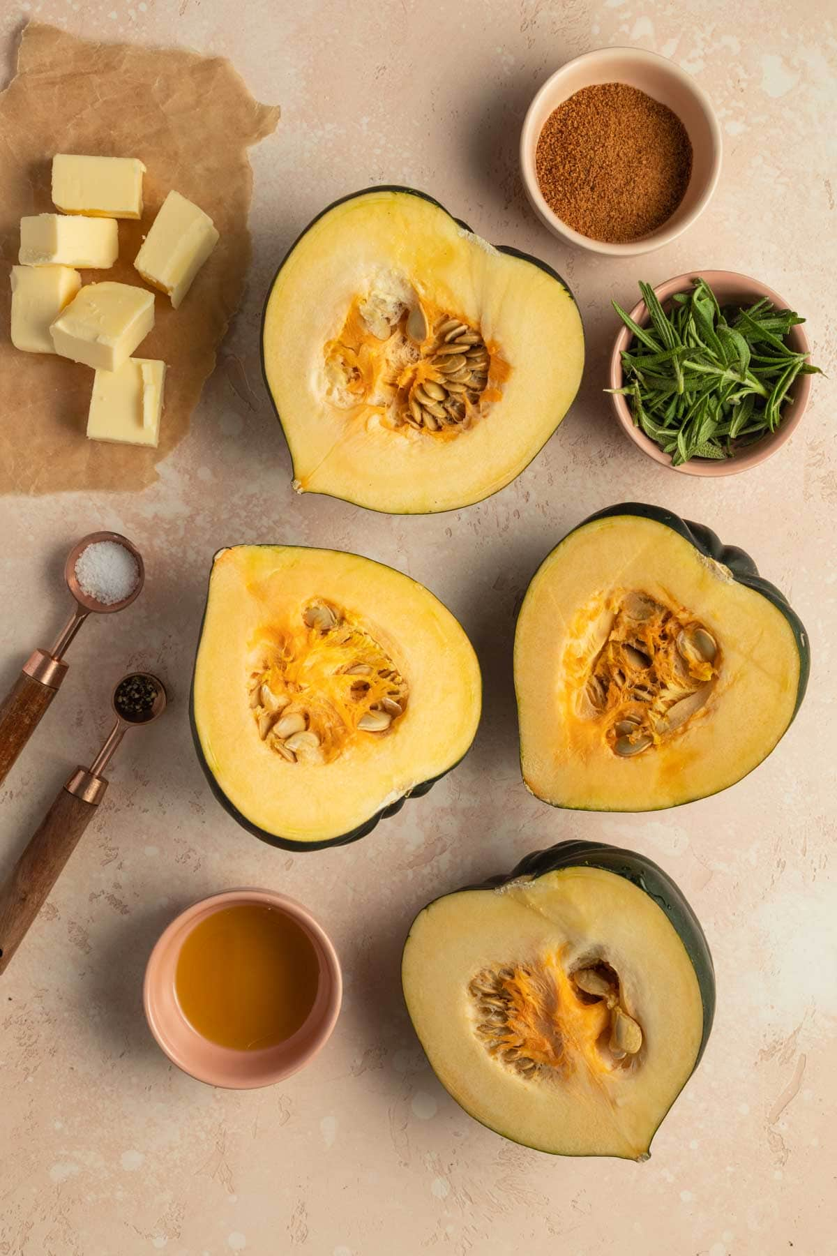 Overhead view of ingredients to make mashed acorn squash arranged individually.